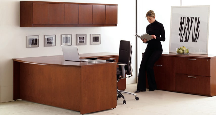 Woman standing at desk