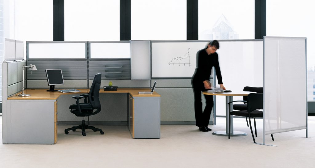 Panel systems add a pastel color for trendy office interior design.