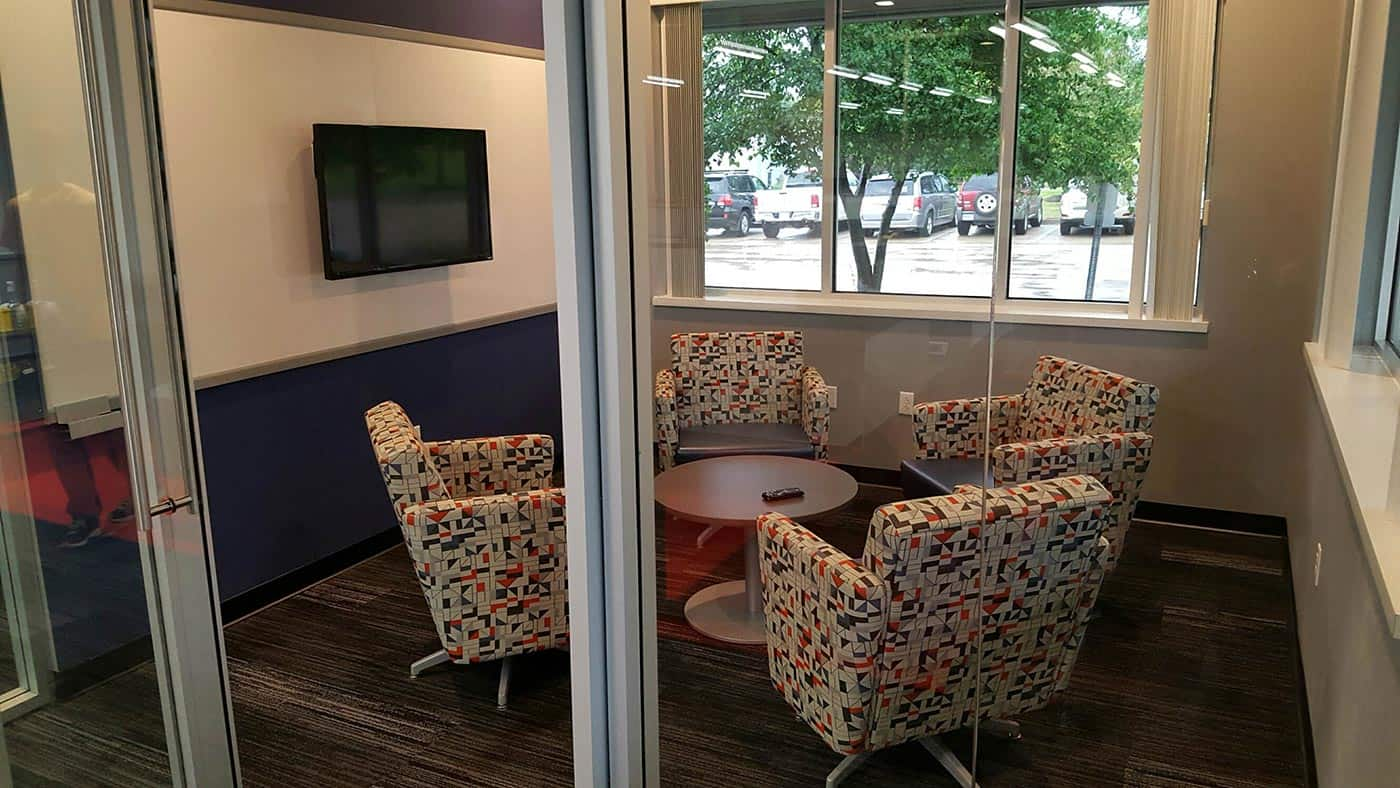 Meeting room with glass walls and door