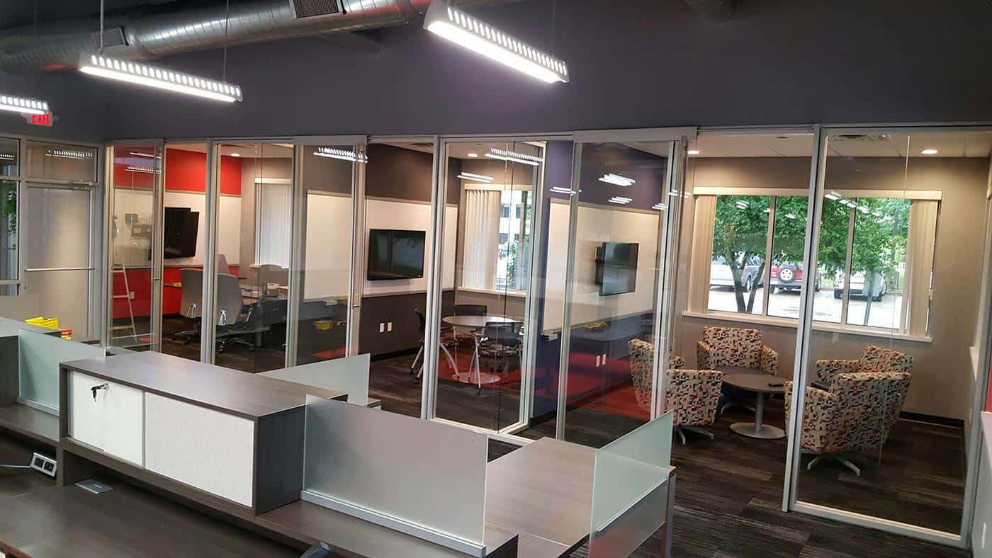 Meeting and conference rooms with sliding glass walls for audible privacy