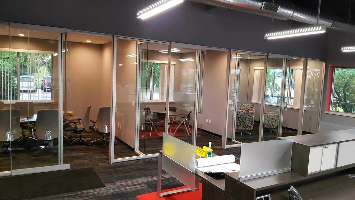 Meeting and conference rooms with sliding glass walls used for privacy.